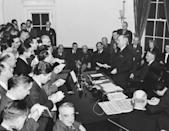 """<p>In Washington D.C., President Harry Truman reads the Victory Proclamation to the press corps, officially announcing the end of the war in Europe. """"The Allied armies, through sacrifice and devotion and with God's help, have wrung from Germany a final and unconditional surrender,"""" he said. """"The Western world has been freed of the evil forces which for five years and longer have imprisoned the bodies and broken the lives of millions upon millions of free-born men. They have violated their churches, destroyed their homes, corrupted their children, and murdered their loved ones. Our Armies of Liberation have restored freedom to these suffering peoples, whose spirit and will the oppressors could never enslave.""""</p>"""