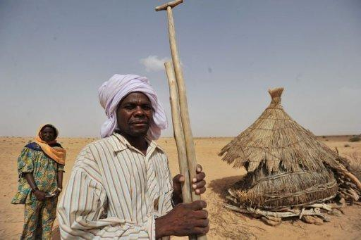 Nigerien farmer Oumarou Hassane and his wife stand in a dried-out field near the southern town of Tanout in the southern Zinder region. In Niger, six million people out of the 18 million in the desert Sahel region of west Africa are threatened with famine each year, according to the United Nations