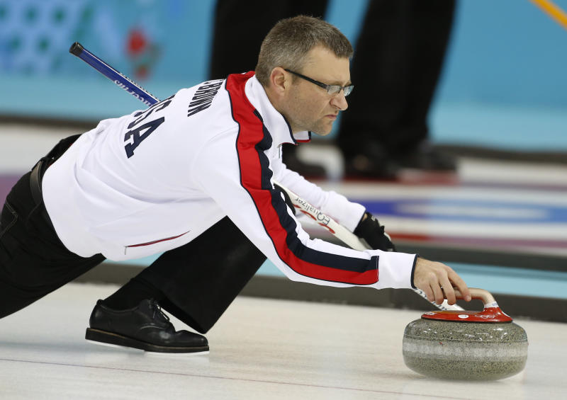 Craig Brown, an alternate on Team USA, delivers the stone during a men's curling training session the 2014 Winter Olympics, Sunday, Feb. 9, 2014, in Sochi, Russia. (AP Photo/Robert F. Bukaty)