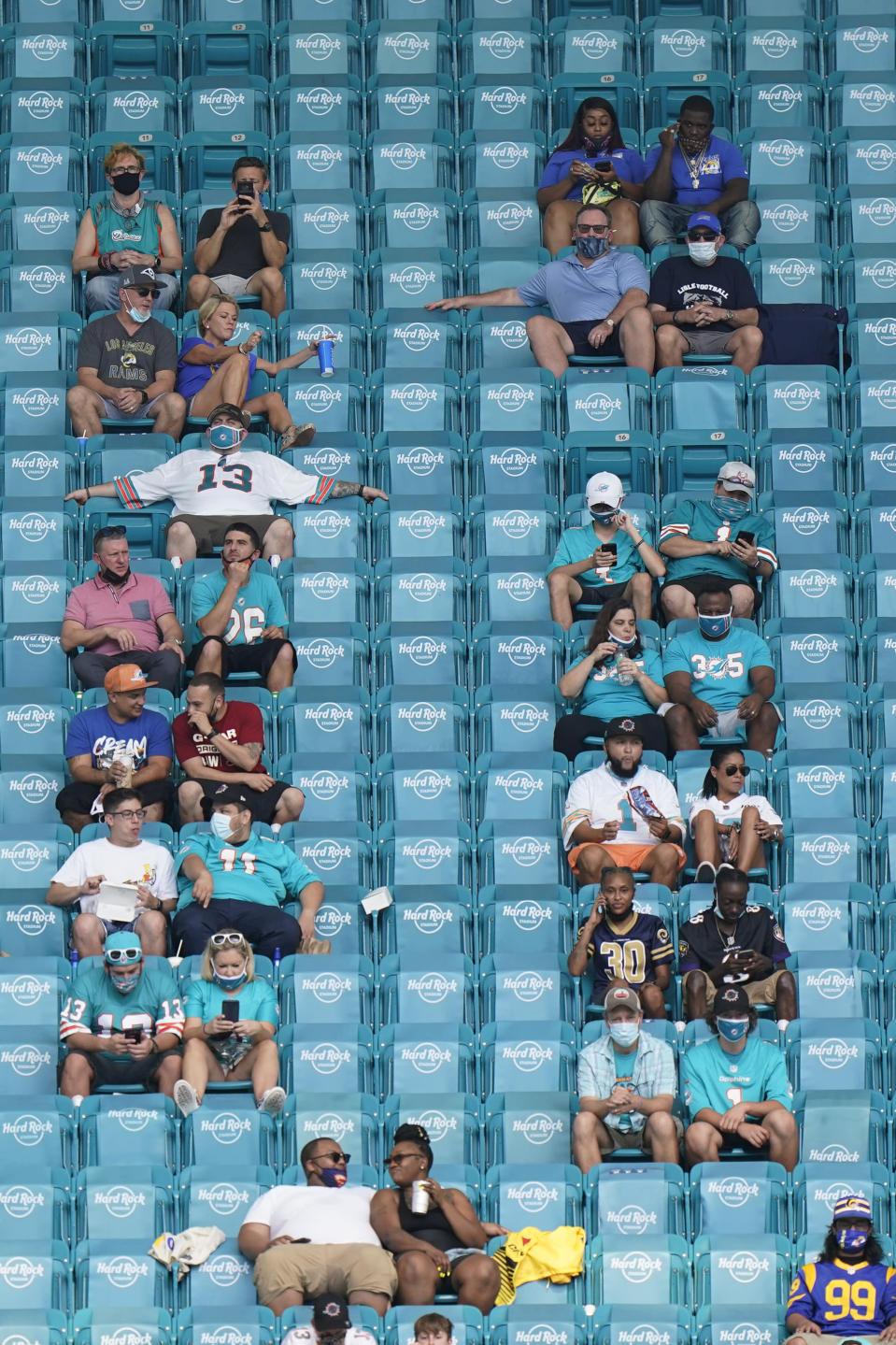 Fans watch during the first half of an NFL football game between the Miami Dolphins and the Los Angeles Rams, Sunday, Nov. 1, 2020, in Miami Gardens, Fla. (AP Photo/Wilfredo Lee)