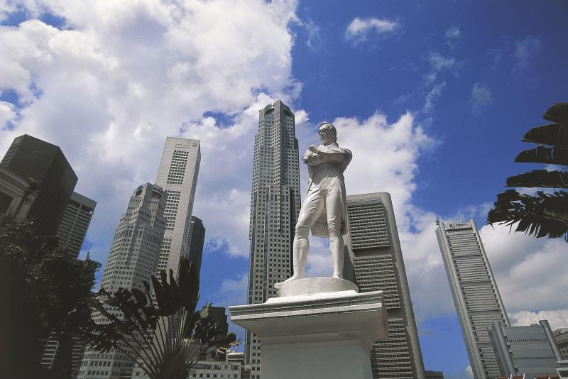 Statue of Thomas Stamford Raffles (1781-1826), founder of the city, with the Central Business District in the background, Singapore.