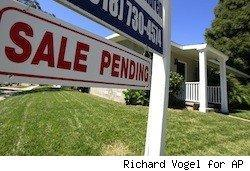 home with sale pending sign