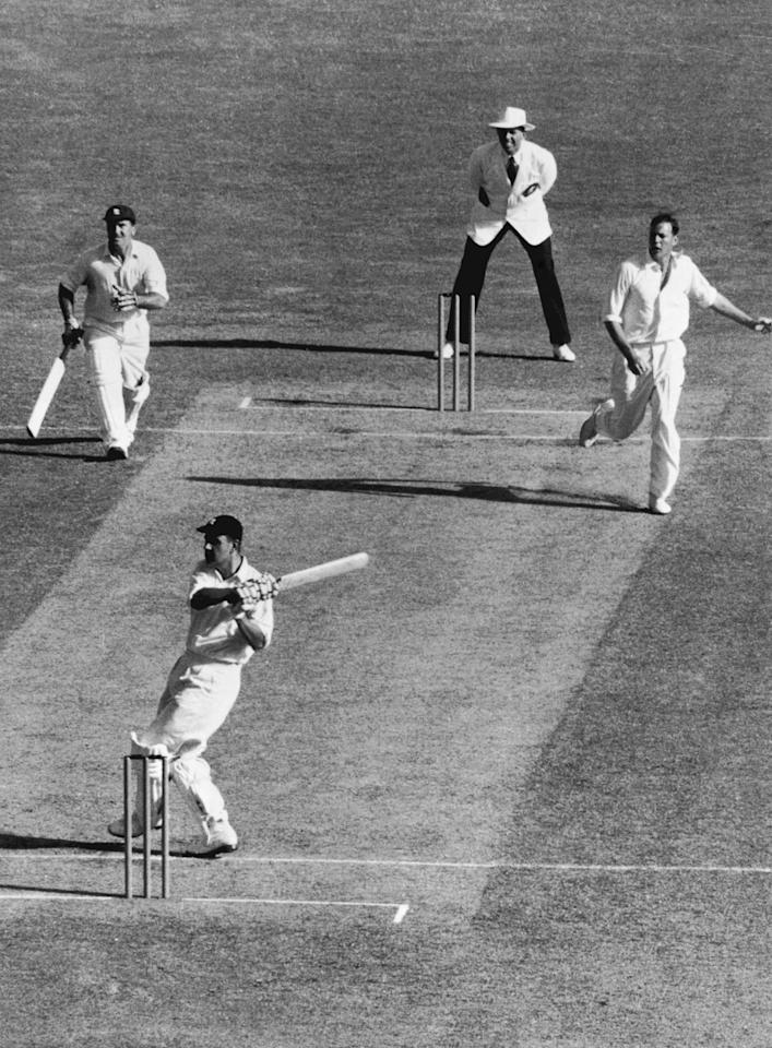 6th January 1955: England cricketer Colin Cowdrey (1932 - 2000) hooks Australian Ron Archer on his way to his first test century in the 3rd Test in Melbourne.  (Photo by Central Press/Getty Images)