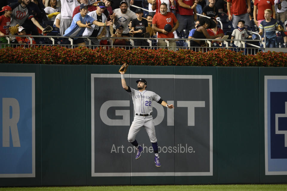 Colorado Rockies left fielder Sam Hilliard (22) makes a catch on a ball hit by Washington Nationals' Yadiel Hernandez for the out during the fourth inning of a baseball game Friday, Sept. 17, 2021, in Washington. (AP Photo/Nick Wass)