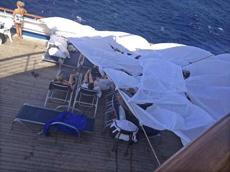 This undated photo provided by passenger Don Hoggatt, of Dallas, shows makeshift tents on the deck of the Carnival Triumph cruise ship for people to spend the day in and sleep in to escape the stench from the lower decks of the disabled ship.The Triumph arrived late Thursday, Feb. 14, 2013, in Mobile, Ala., after an engine-room fire left the ship powerless off Mexico last weekend. (AP Photo/Don Hoggatt)