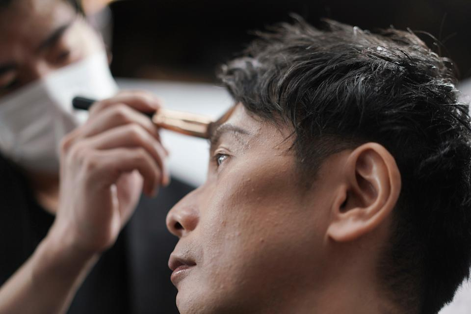 <p>A man gets his make-up done at a salon in Tokyo.  Businessmen have been visiting them in increasing numbers during the pandemic</p> (AP)