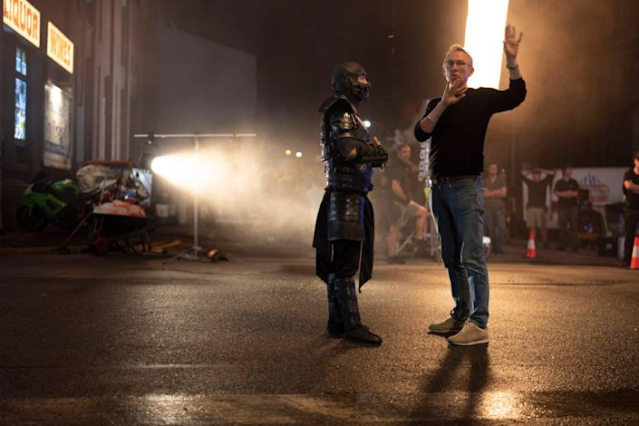 """Sub-Zero (Joe Taslim) and director Simon McQuoid on the set of """"Mortal Kombat."""" McQuoid had to ask his star to slow down his moves for the camera. """"He just gets on set and he just becomes this beast,"""" McQuoid says."""