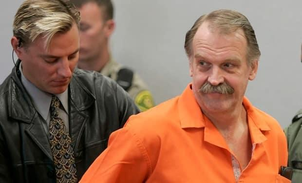 In this 2005 file photo, convicted murderer and death row inmate Ron Lafferty is handcuffed after his court hearing in a courtroom in Provo, Utah. Lafferty's double-murder case was featured in the book Under the Banner of Heaven, written by Jon Krakauer. (The Associated Press - image credit)
