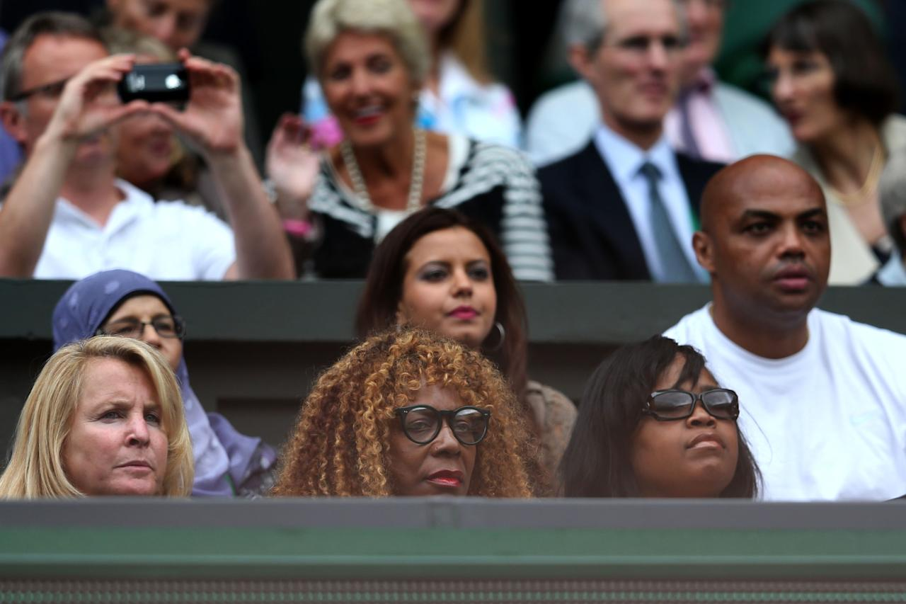 LONDON, ENGLAND - JULY 07:  Oracene Price (C) and Charles Barkley (R) look on ahead of the Ladies' Singles final match between Serena Williams of the USA and Agnieszka Radwanska of Polandon day twelve of the Wimbledon Lawn Tennis Championships at the All England Lawn Tennis and Croquet Club on July 7, 2012 in London, England.  (Photo by Julian Finney/Getty Images)