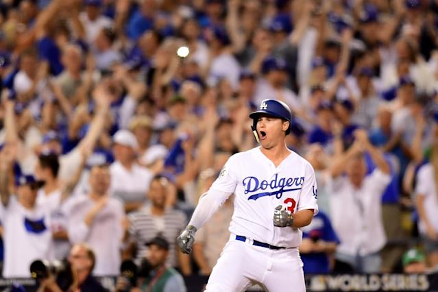 <p>Joc Pederson #31 of the Los Angeles Dodgers celebrates after hitting a solo home run during the fifth inning against the Houston Astros in game two of the 2017 World Series at Dodger Stadium on October 25, 2017 in Los Angeles, California. (Photo by Harry How/Getty Images) </p>