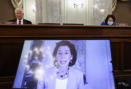 Commerce secretary-nominee Rhode Island Gov. Gina Raimondo testifies remotely during her nomination hearing before the Senate Commerce, Science and Transportation Committee on Capitol Hill in Washington, Tuesday, Jan. 26, 2021. (Jonathan Ernst/Pool via AP)