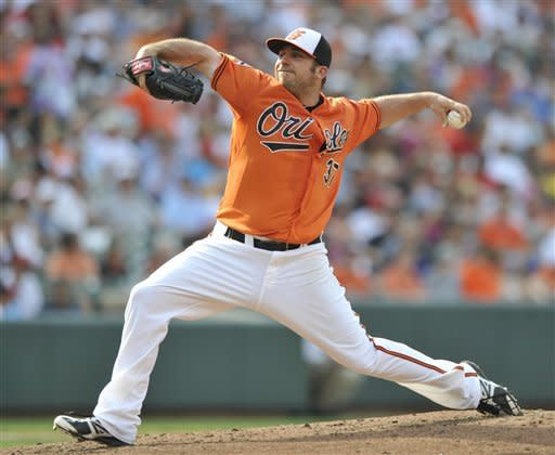 Baltimore Orioles starting pitcher Dana Eveland delivers against the Cleveland Indians during the third inning of a baseball game Saturday, June 30, 2012 in Baltimore.(AP Photo/Gail Burton)