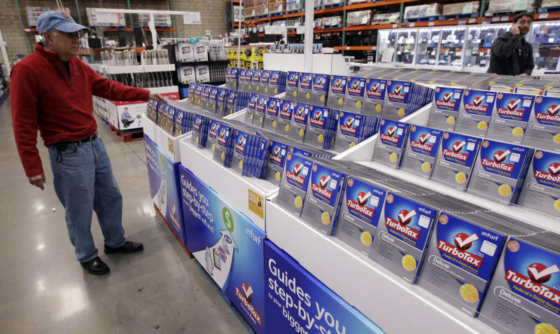 In this Jan 24, 2012 photo, a shopper looks at a copy of TurboTax on sale at Costco in Mountain View, Calif. Costco Wholesale Corp.'s fiscal second-quarter net income rose 13 percent as sales improved and it made more money from membership fees. The wholesale club operator's performance topped Wall Street's expectations. (AP Photo/Paul Sakuma)