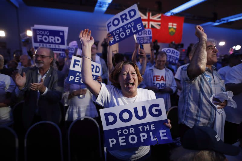 Supporters of Ontario's Progressive Conservatives react to his victory in the Ontario provincial election at his election night headquarters in Toronto on Thursday, June 7, 2018. Photo from The Canadian Press.