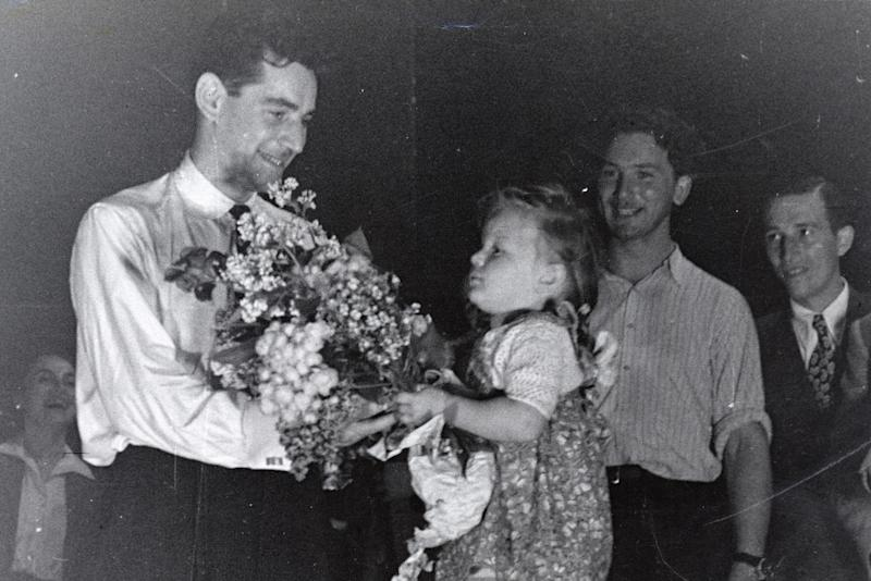 Leonard Bernstein receives plants from an admirer after conducting an orchestra of focus camp survivors for a concert subsidized by the American Jewish Joint Distribution Committee on Might well perchance also objective 10, 1948, launch air Munich.