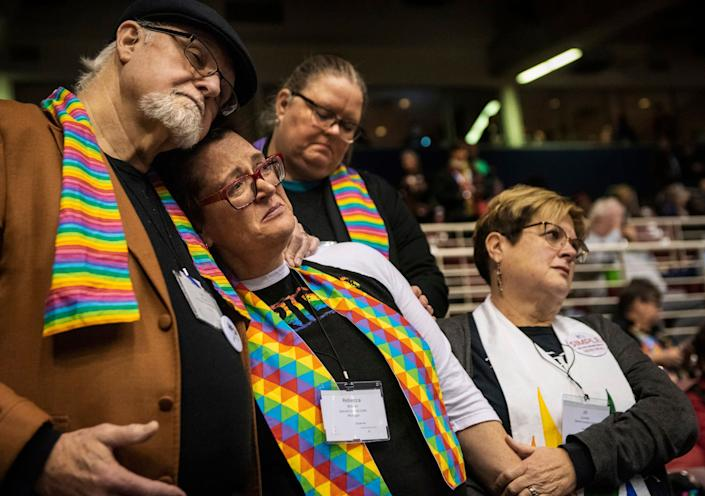 Ed Rowe, left, Rebecca Wilson, Robin Hager and Jill Zundel, react to the defeat of a proposal that would allow LGBT clergy and same-sex marriage within the United Methodist Church at the denomination's 2019 Special Session of the General Conference in St. Louis, Mo., Tuesday, February 26, 2019. America's second-largest Protestant denomination faces a likely fracture as delegates at the crucial meeting move to strengthen bans on same-sex marriage and ordination of LGBT clergy.
