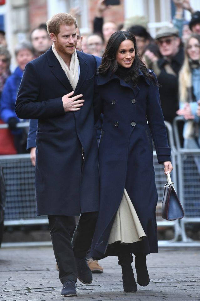 <p>The double-breasted military maxi coat by Canadian outerwear label Mackage is an old favourite of Markle's. She's been photographed wearing it on a number of occasions, while arriving in and leaving Heathrow. (<em>Photo: Getty)</em> </p>