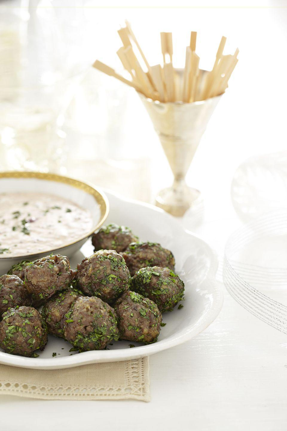 """<p>These appetizers might be small but are packed with surprising flavor. Your guests will definitely be back for second and third helpings.</p><p><em><a href=""""https://www.goodhousekeeping.com/food-recipes/a14458/cocktail-meatballs-creamy-cranberry-sauce-recipe-ghk1212/"""" rel=""""nofollow noopener"""" target=""""_blank"""" data-ylk=""""slk:Get the recipe for Cocktail Meatballs with Creamy Cranberry Sauce »"""" class=""""link rapid-noclick-resp"""">Get the recipe for Cocktail Meatballs with Creamy Cranberry Sauce »</a></em> </p>"""