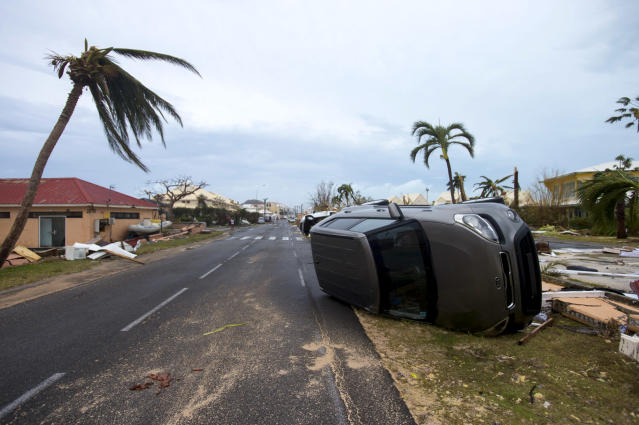 <p>A car is turned onto its side in Marigot, near the Bay of Nettle, on the French Collectivity of Saint Martin, after the passage of Hurricane Irma on Sept. 6, 2017. (Photo: Lionel Chamoiseau/AFP/Getty Images) </p>