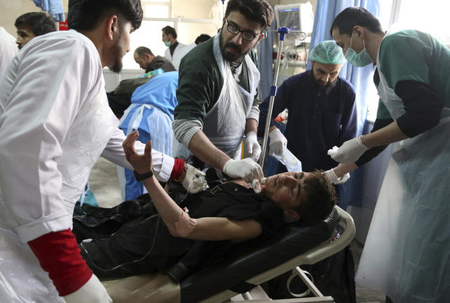 <p>Afghan Injured men receives a treatment at a hospital after a suicide attack in Kabul, Afghanistan, Saturday Jan. 27, 2018. (Photo: Rahmat Gul/AP) </p>