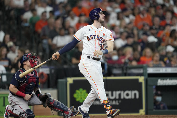 Houston Astros' Kyle Tucker (30) hits a two-run single as Boston Red Sox catcher Christian Vazquez watches during the sixth inning of a baseball game Monday, May 31, 2021, in Houston. (AP Photo/David J. Phillip)
