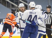 Toronto Maple Leafs' William Nylander (88), Morgan Rielly (44) and Mitchell Marner (16) celebrate a goal against the Edmonton Oilers during first-period NHL hockey game action in Edmonton, Alberta, Monday, March 1, 2021. (Jason Franson/The Canadian Press via AP)