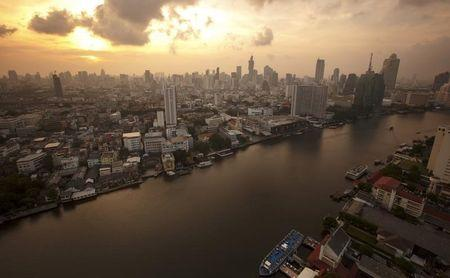 The skyline of central Bangkok and the Chao Phraya river are seen during sunrise in Bangkok