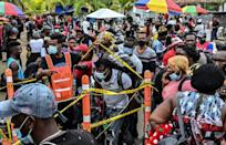 Migrants from Haiti, Cuba and elsewhere in Necocli in northern Colombia, hoping to make their way northward to the United States (AFP/JOAQUIN SARMIENTO)