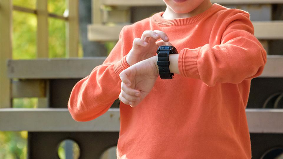 young boy with smart watch