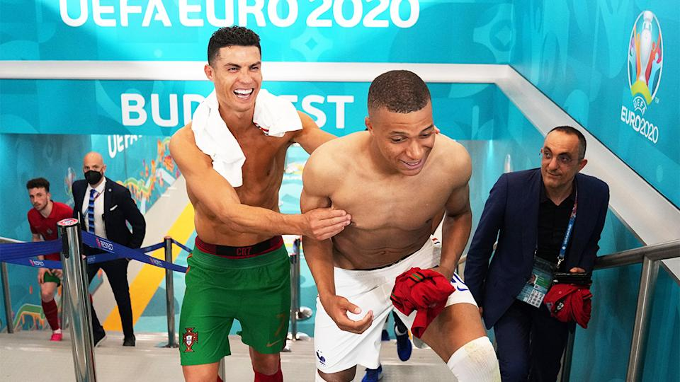 Cristiano Ronaldo (pictured left) and Kylian Mbappe (pictured right) laughing in the tunnel at Euro 2020.