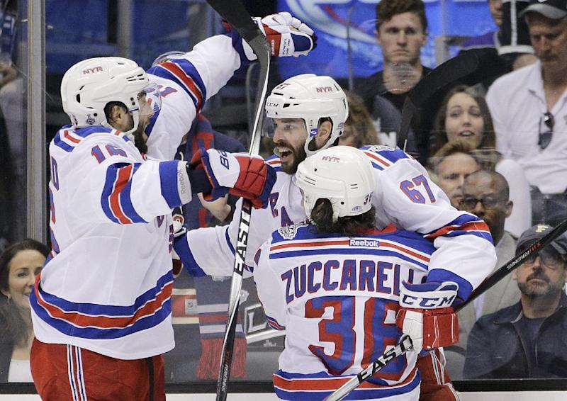 New York Rangers left wing Benoit Pouliot, middle, celebrates his goal against the Los Angeles Kings with right wing Mats Zuccarello, of Norway, right, and Derick Brassard  during the first period in Game 1 of the NHL hockey Stanley Cup Finals, Wednesday, June 4, 2014, in Los Angeles