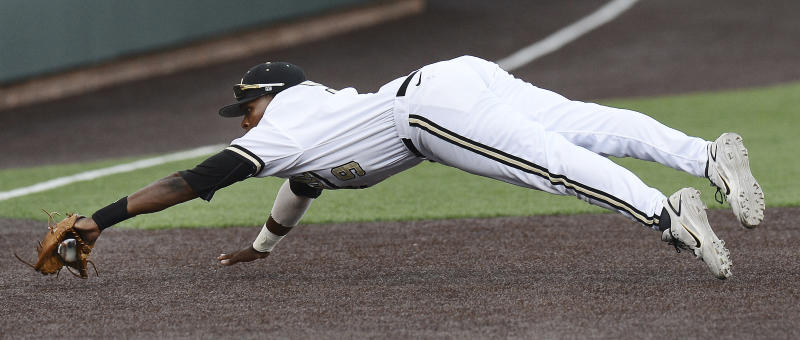 Vanderbilt third baseman Xavier Turner dives to stop a ground ball by a Georgia Tech batter, who was out in the fourth inning of an NCAA college baseball tournament regional game Monday, June 3, 2013, in Nashville, Tenn. (AP Photo/Mark Zaleski)