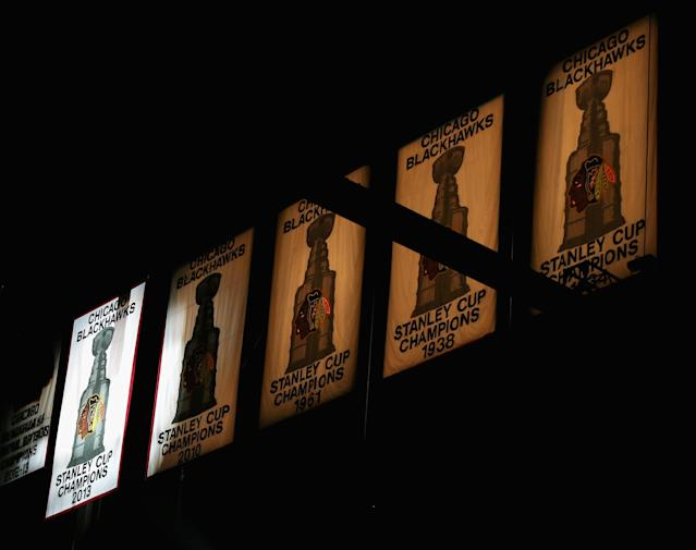 CHICAGO, IL - OCTOBER 01: The 2013 Stanley Cup Champions banner joins 4 other Stanley Cup banners at the United Center during a ceremony before the Chicago Blackhawks take on the Washington Capitals at the United Center on October 1, 2013 in Chicago, Illinois. (Photo by Jonathan Daniel/Getty Images)