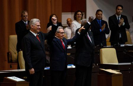 Cuban President Miguel Diaz-Canel (L), Cuban Communist Party leader Raul Castro (C) and National Assembly President Esteban Lazo react during the enactment of the new constitution, in Havana, Cuba April 10, 2019.  Irene Perez/Courtesy Cubadebate/Handout via REUTERS