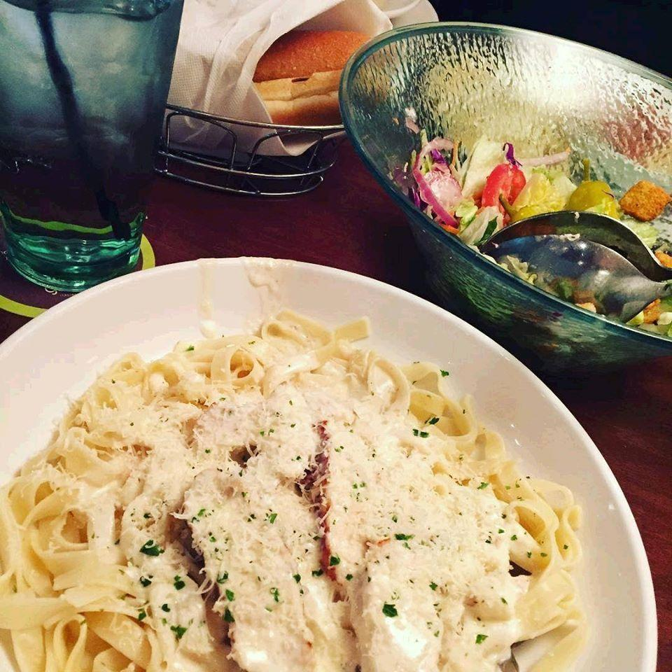 """<p>No, the fluffy, buttery breadsticks don't count. <a href=""""https://www.delish.com/food-news/a46294/things-you-need-to-know-about-olive-garden/"""" rel=""""nofollow noopener"""" target=""""_blank"""" data-ylk=""""slk:Chicken Alfredo"""" class=""""link rapid-noclick-resp"""">Chicken Alfredo</a> is the most popular dish that you actually have to order and pay for at Olive Garden. <a href=""""https://www.popsugar.com/food/Olive-Garden-Secrets-Revealed-43549282"""" rel=""""nofollow noopener"""" target=""""_blank"""" data-ylk=""""slk:An employee told PopSugar"""" class=""""link rapid-noclick-resp"""">An employee told PopSugar</a> that fettucine noodles are customers' favorite kind of pasta, and grilled chicken is customers' favorite topping. Put those together with creamy Alfredo sauce and you've got yourself a winner.</p>"""