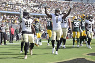 New Orleans Saints running back Alvin Kamara (41) celelbrates his touchdown against the Green Bay Packers with teammates including wide receiver Marquez Callaway (1) during the first half of an NFL football game, Sunday, Sept. 12, 2021, in Jacksonville, Fla. (AP Photo/Phelan M. Ebenhack)