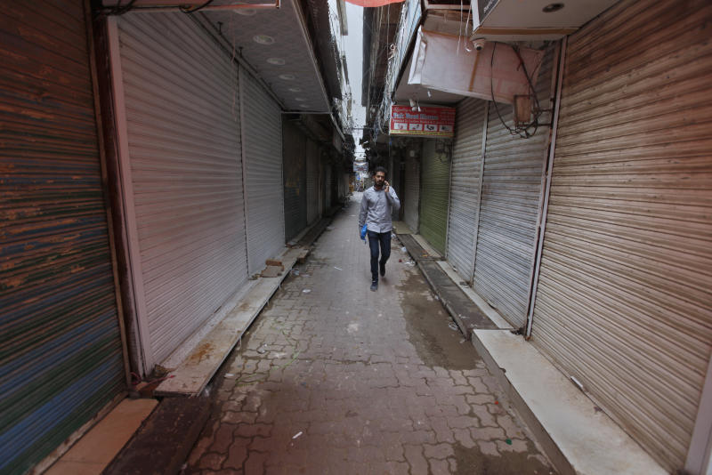 A Pakistani man walks through a main market which is closed due to a strike in Rawalpindi, Pakistan, Saturday, July 13, 2019. Pakistani traders have largely kept their business shut across the country against the new sales tax regime in the first budget of the new government they and opposition parties said came on the diktat of International Monetary Fund in turn of a $6bn bailout package. (AP Photo/Anjum Naveed)