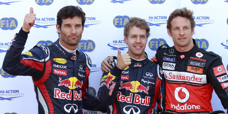 Red Bull driver Sebastian Vettel of Germany, center, pole position, McLaren Mercedes driver Jenson Button of Britain, right, second fastest time and Red Bull driver Mark Webber of Australia, third fastest time, pose after the qualifying session at the Monaco racetrack, in Monaco, Saturday, May 28, 2011. The Formula one race will be held on Sunday. (AP Photo/Luca Bruno)