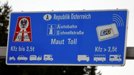 FILE PHOTO: A sign advertising the sale of Austrian motorway road toll stickers is seen on the A8 highway near the German/Austrian border
