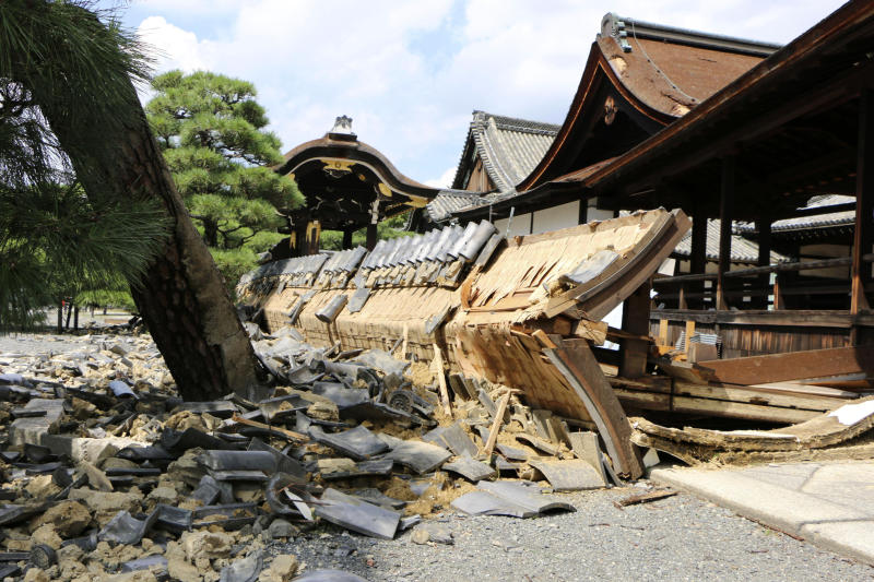 A wall of Minami Noh Butai of Nishi Honganji temple, a world heritage site, is damaged by a powerful typhoon in Kyoto, western Japan, Wednesday, Sept. 5, 2018. Typhoon Jebi peeled roofs off buildings, toppled power poles and damaged businesses as it crossed Japan's main island Tuesday. (Kyodo News via AP)