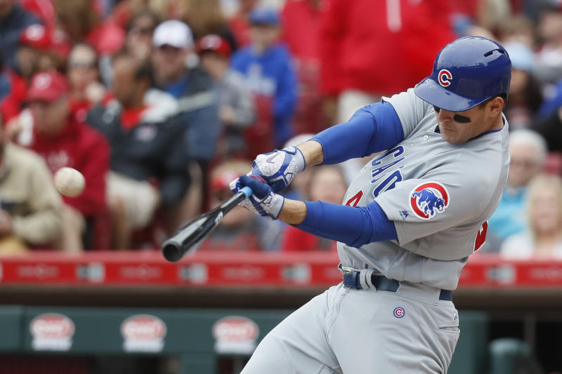 Chicago Cubs' Anthony Rizzo hits a two-run home run off Cincinnati Reds starting pitcher Bronson Arroyo in the fourth inning of a baseball game, Sunday, April 23, 2017, in Cincinnati. (AP Photo/John Minchillo)
