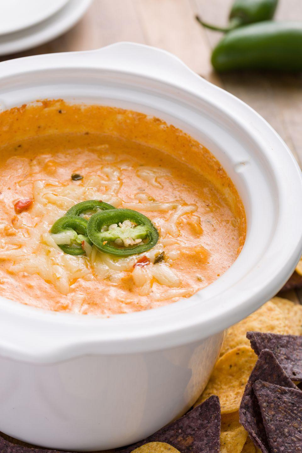 """<p>Enchilada sauce and pepper jack shine in this gloriously cheesy dip.</p><p>Get the recipe from <a href=""""https://www.delish.com/cooking/recipe-ideas/recipes/a44668/slow-cooker-chicken-enchilada-dip-recipe/"""" rel=""""nofollow noopener"""" target=""""_blank"""" data-ylk=""""slk:Delish"""" class=""""link rapid-noclick-resp"""">Delish</a>. </p>"""