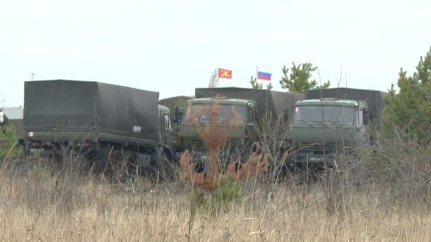 The Russian flag flies over a temporary military base about 200 kilometres from the Ukraine border. (Dmitry Kozlov/CBC - image credit)