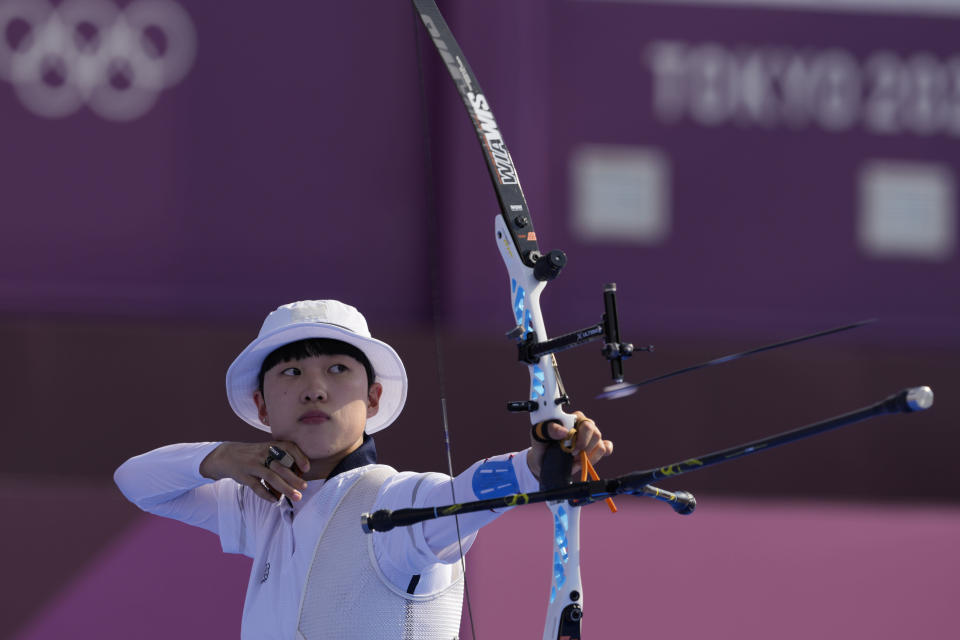 South Korea's An San releases an arrow during the mixed team competition at the 2020 Summer Olympics, Saturday, July 24, 2021, in Tokyo, Japan. (AP Photo/Alessandra Tarantino)