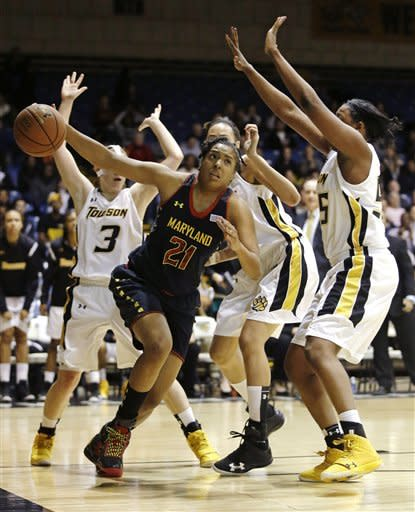 Maryland forward Tianna Hawkins (21) drives to the basket past Towson guard Ciara Webb, from back left, forward Michelle Peebles and forward Nyree Williams during the first half of an NCAA college basketball game in Towson, Md., Tuesday, Dec. 11, 2012. (AP Photo/Patrick Semansky)