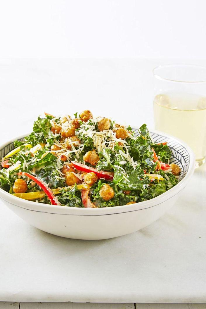 """<p>Who needs croutons when you've got crispy chickpeas to go on top of a kale, parmesan, and bell pepper salad?</p><p><u><em>Get the recipe from <a href=""""https://www.goodhousekeeping.com/food-recipes/a38876/crunchy-chickpea-kale-caesar-recipe/"""" rel=""""nofollow noopener"""" target=""""_blank"""" data-ylk=""""slk:Good Housekeeping"""" class=""""link rapid-noclick-resp"""">Good Housekeeping</a>. </em></u></p>"""