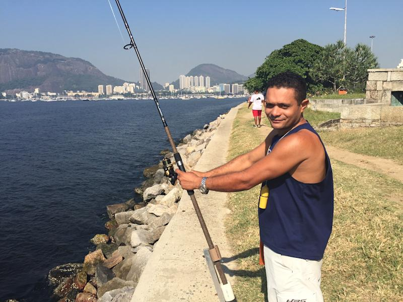 Juan Carlos Daniel doesn't plan to stop fishing Guanabara Bay. (Getty Images)