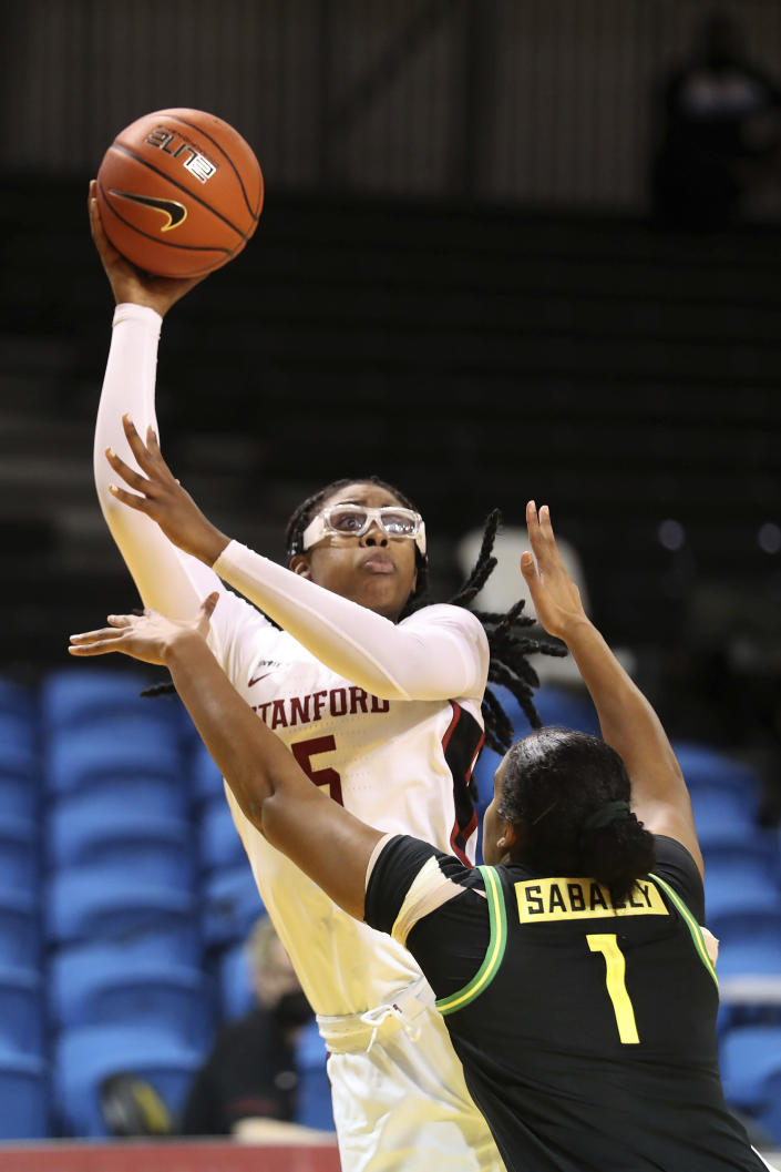 Stanford forward Francesca Belibi shoots against Oregon forward Nyara Sabally during the first half of an NCAA college basketball game in Santa Cruz, Calif., Friday, Jan. 8, 2021. (AP Photo/Jed Jacobsohn)