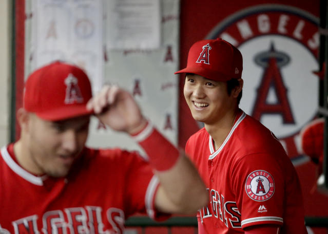 Los Angeles Angels' Shohei Ohtani, of Japan, smiles in the dugout with Mike Trout before a baseball game against the Texas Rangers in Anaheim, Calif., Wednesday, Sept. 12, 2018. (AP Photo/Chris Carlson)
