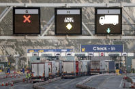 Goods lorries enter the ferry terminal at Port of Dover, in southern England, the main ferry link with France and other northern Europe ports, late Thursday Dec. 31, 2020. The last ferries are crossing the border into northern Europe before the Brexit transition period concludes, and Britain begins its new relationship with the trading bloc from Jan. 1. (Gareth Fuller/PA via AP)